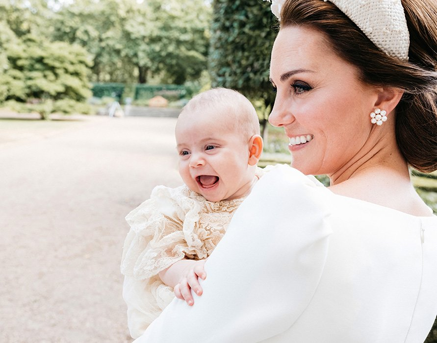The royal fans also noticed Kate and Prince Louis' stunning picture together at the latter's christening smiling brightly.